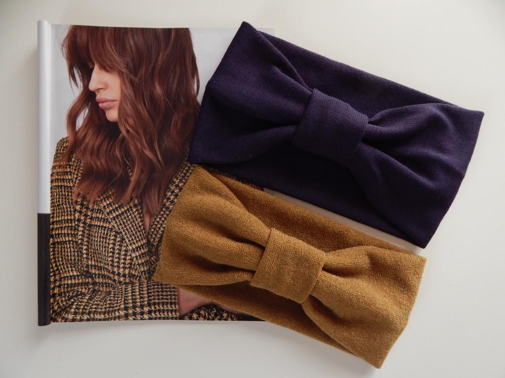 Fasce in maglia rasata ocra e viola. Tendenza: tartan.